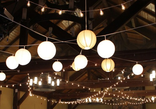 With over 400 bulbs strung overhead, our lights can be dimmed to balance with the ambient lighting.