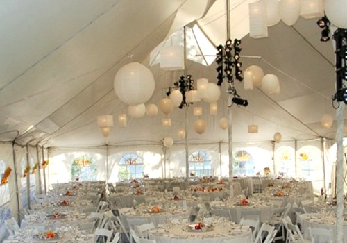 Pin spot lighting and Japanese lanterns create a smooth transition between daylight to evening celebration.